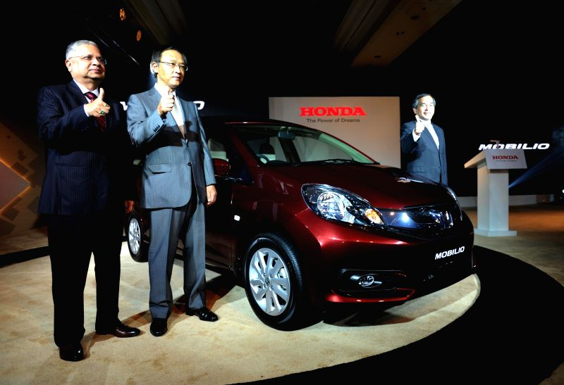 Honda Cars India Limited Senior VP and Director Mr. Raman Sharma, President & CEO, Honda Cars India Limited Hironiri Kanayama and Honda Motor Company Managing Officer Yoshiyuki Matsumoto during .. - Raman Sharma