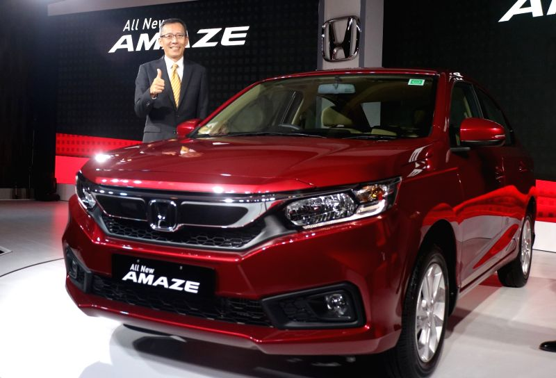 Honda Cars India Ltd (HCIL) President and CEO Gaku Nakanishi with the newly launched  Honda Amaze, in New Delhi on May 16, 2018.