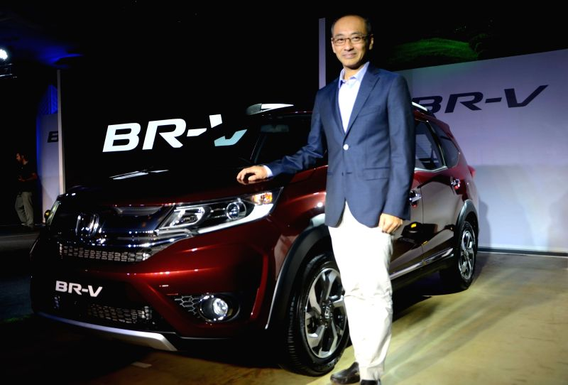 Honda President and CEO Yoichiro Ueno unveils new Honda BR-V in Mumbai, on May 5, 2016.