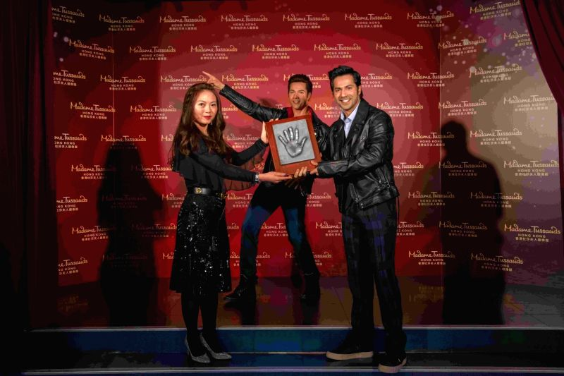 Hong Kong: Actor Varun Dhawan poses next to his wax statue at Madame Tussauds in Hong Kong on Jan 30, 2018. - Varun Dhawan