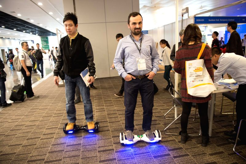 Exhibitors present a type of electric scooter glider at the Hong Kong Electronics Fair (Spring Edition) in south China's Hong Kong, April 13, 2015. The four-day ...