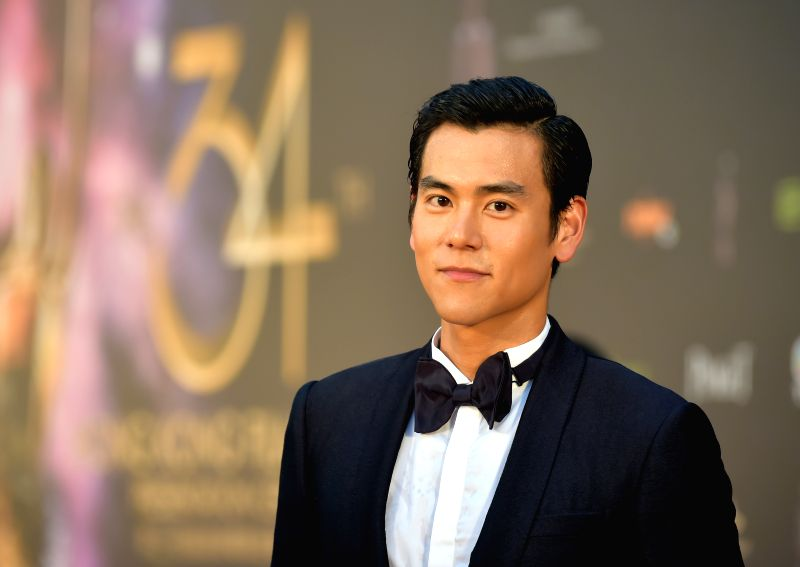 Eddie Peng, nominee for the best actor, walks the red carpet before the 34th Hong Kong Film Awards presentation ceremony in Hong Kong, south China, April 19, ...