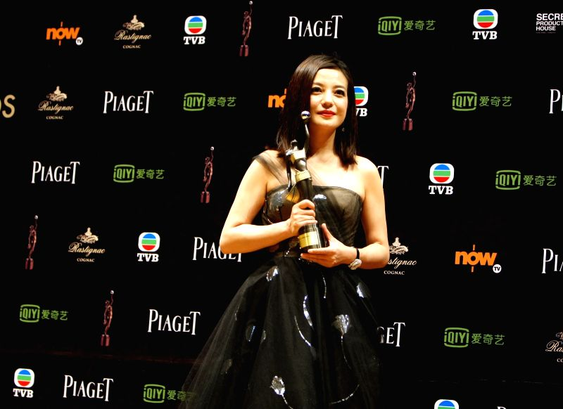 Actress Zhao Wei holds the best actress award for her role in the movie 'Dearest' at the 34th Hong Kong Film Awards in Hong Kong, south China, April 19, 2015.  ... - Zhao Wei