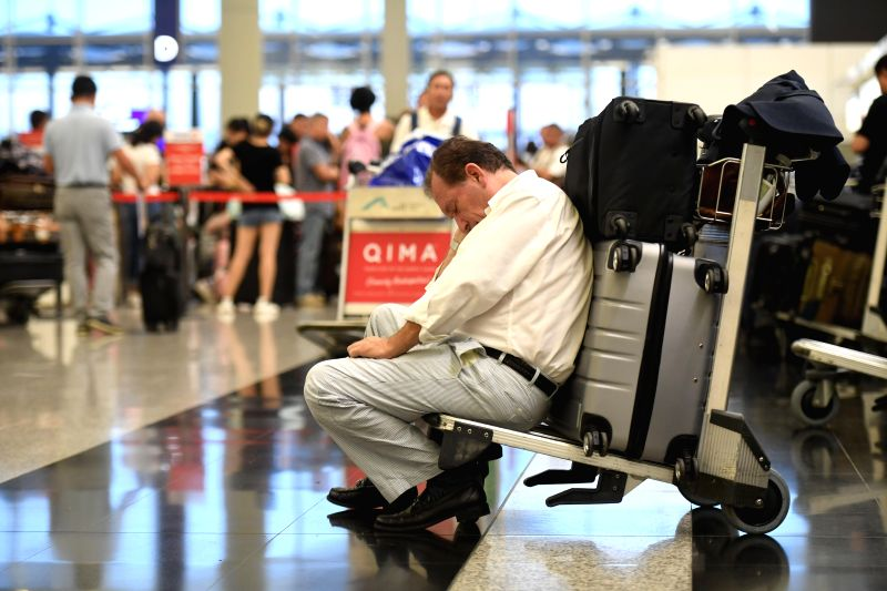 HONG KONG, Aug. 14, 2019 (Xinhua) -- Tourists are stranded due to chaos caused by protesters at Hong Kong International Airport in Hong Kong, south China, Aug. 13, 2019. Protesters created chaos at the Hong Kong International Airport for the second d