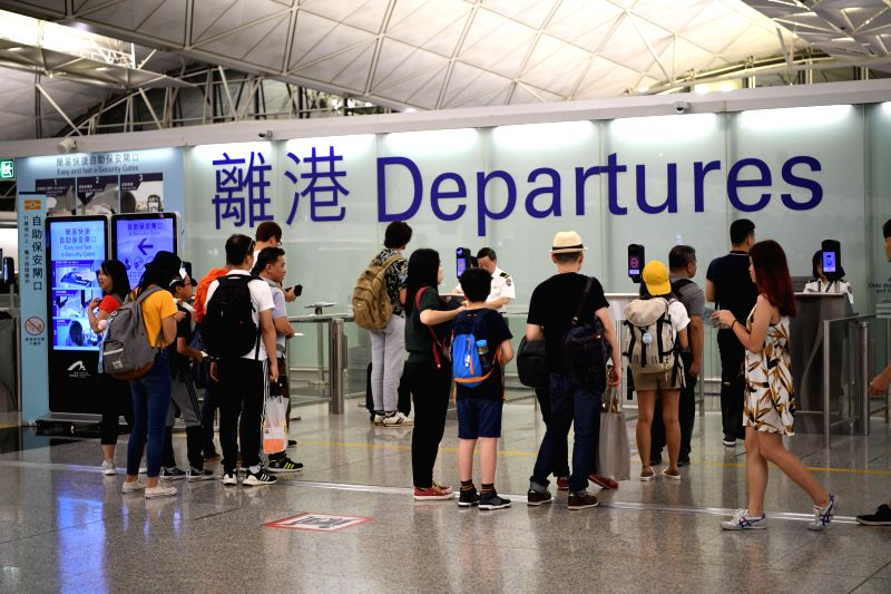 HONG KONG, Aug. 15, 2019 (Xinhua) -- Photo taken on Aug. 15, 2019 shows travellers at Hong Kong International Airport in Hong Kong, south China.   The operation of Hong Kong International Airport returned to normal on Thursday, the Airport Authority