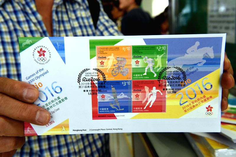 "HONG KONG, Aug. 5, 2016 - A resident shows ""Games of the XXXI Olympiad Rio 2016"" stamps in Hong Kong, south China, Aug. 5, 2016. Hong Kong Post issued a set of stamps Friday with the theme ..."