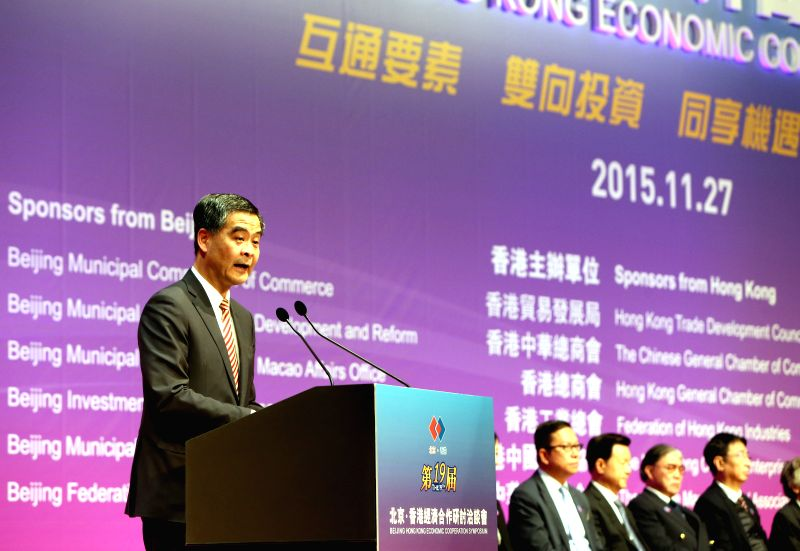Hong Kong Chief Executive Leung Chun-ying addresses the opening ceremony of the 19th Beijing Hong Kong Economic Cooperation Symposium in south China's Hong Kong, ...