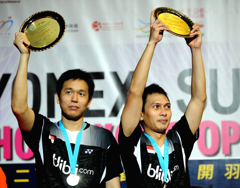 Hong Kong: Hendra Setiawan(L) and Mohammad Ahsan of Indonesia show their trophies during the awarding ceremony for the men's double final of Yonex-Sunrise Hong Kong Open Badminton Tournament at Hong .