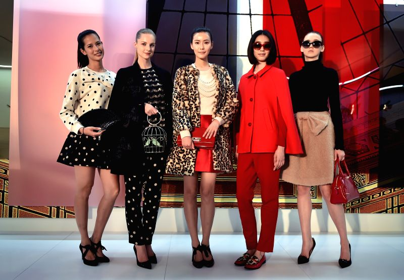 Models show creations at the preview of the autumn fashion collection of Kate Spade in Hong Kong, south China, July 3, 2014.
