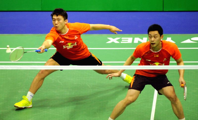 Hong Kong: Liu Xiaolong and Qiu Zihan(L) of China return the ball during the men's double final of Yonex-Sunrise Hong Kong Open Badminton Tournament at Hong Kong Coliseum in Hong Kong, Nov. 23, 2014.