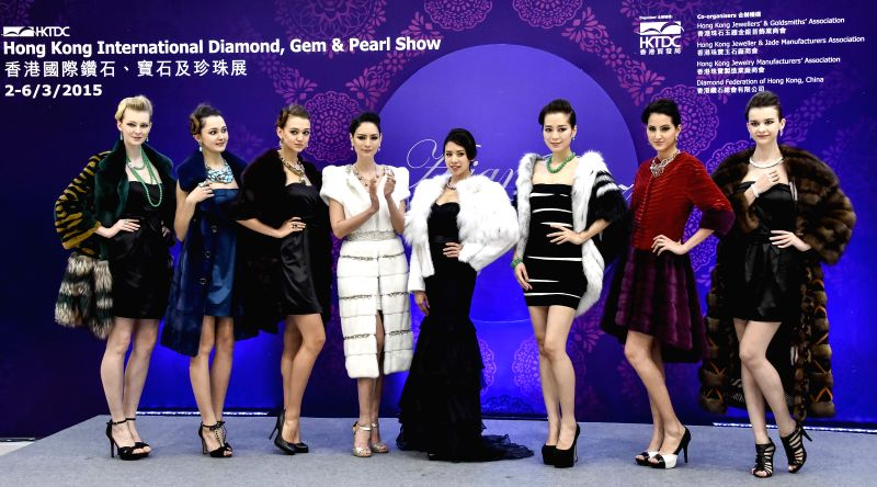 Models show jewelry at the second Hong Kong International Diamond, Gem and Pearl Show in Hong Kong, south China, March 2, 2015.