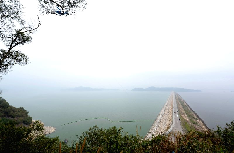 Photo taken on March 3, 2015 shows the Plover Cove Reservoir in Hong Kong, south China. The Plover Cove Reservoir, located within the Plover Cove Country Park, is ...