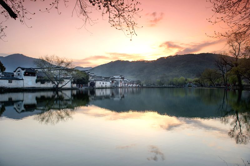 Photo taken on March 25, 2015 shows the morning scenery of Nanhu, or South Lake, at Hongcun, an ancient village in Yixian County of Huangshan City, east China's ...