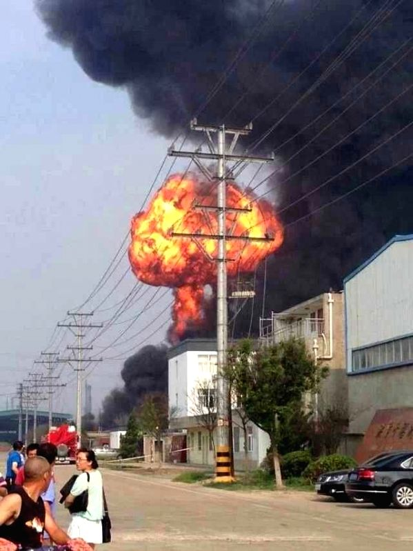 Photo taken with a mobile phone shows fire and smoke rising in an explosion at a chemical plant in Hongze County, Huai'an City, east China's Jiangsu Province, July ..