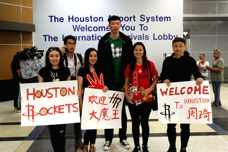 HOUSTON, April 28, 2017 - China's basketball player Zhou Qi (3rd L) poses with fans after he arrived at George Bush Intercontinental Airport in Houston, the United States, on April 27, 2017.