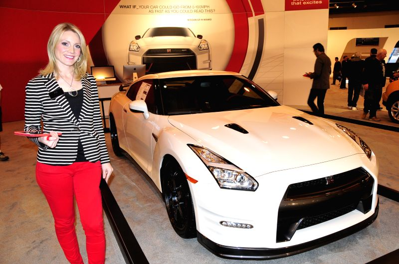 A model stands next to a Nissan GT-R Nismo during the 32nd Houston Auto Show in Houston, the United States, on Jan. 21, 2015.