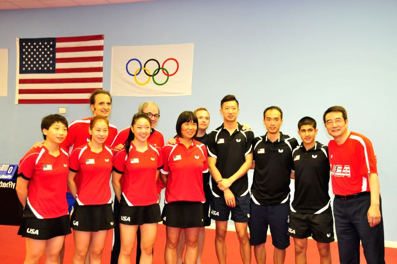 HOUSTON, July. 30, 2016 - Members of team of table tennis of the United States take a group foto before a training game in Houston, U.S., July 29, 2016. The delegation of table tennis of U.S. took ...