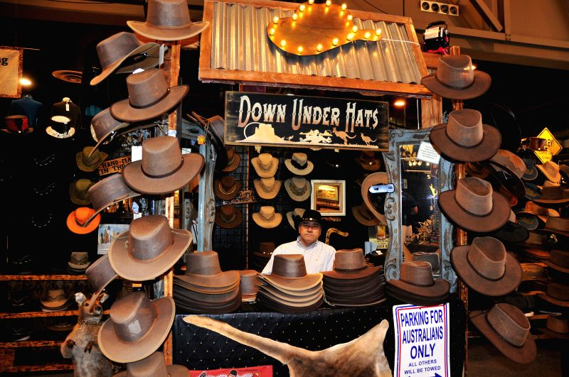 A man sells cowboy hats during the 2015 Houston Livestock Show and Rodeo in Honston, the United States, March 3, 2015. The three-week show opened at the NRG Park on ...