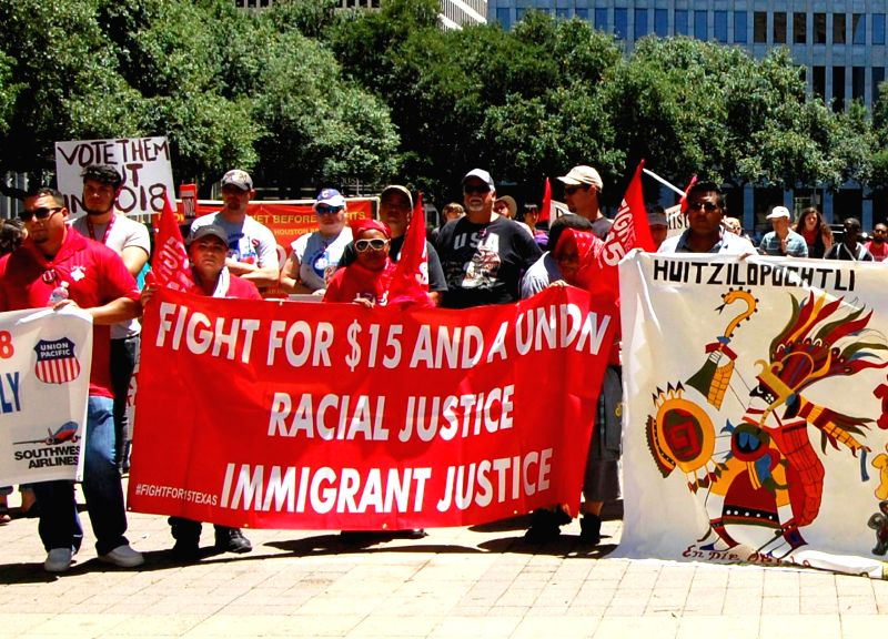 HOUSTON, May 2, 2017 - People attend a march in Houston, the United States, on May 1, 2017. Thousands of Americans on Monday took to streets in major U.S. cities including Washington D.C., Chicago, ...