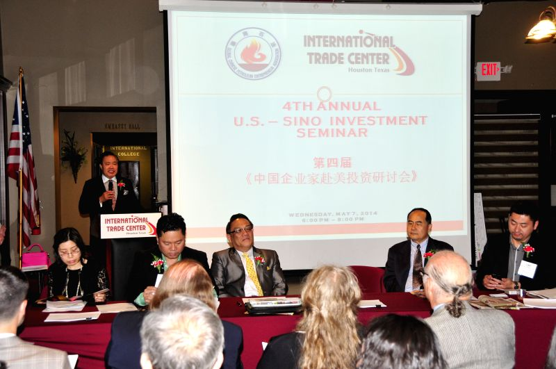 Houston International Trade Center President Wea H. Lee speaks at the 4th Annual Sino-U.S. Investment Seminar in Houston, the United States, May 7, 2014. ...