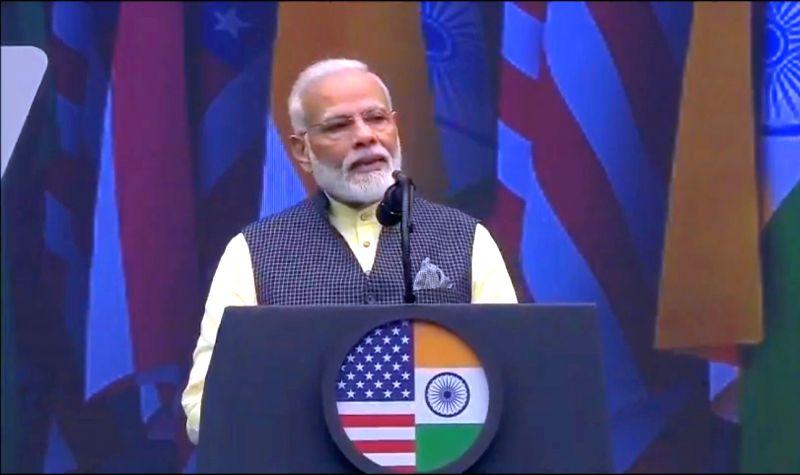 Houston: Prime Minister Narendra Modi addresses during the 'Howdy Modi' event at NRG Stadium in Houston, USA, on Sep 22, 2019. (Photo: IANS/BJP)