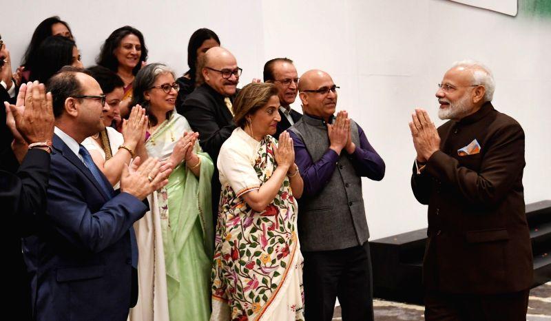 Houston: Prime Minister Narendra Modi meets a delegation of Kashmiri Pandits in Houston, US on Sep 22, 2019. (Photo: IANS/MEA)