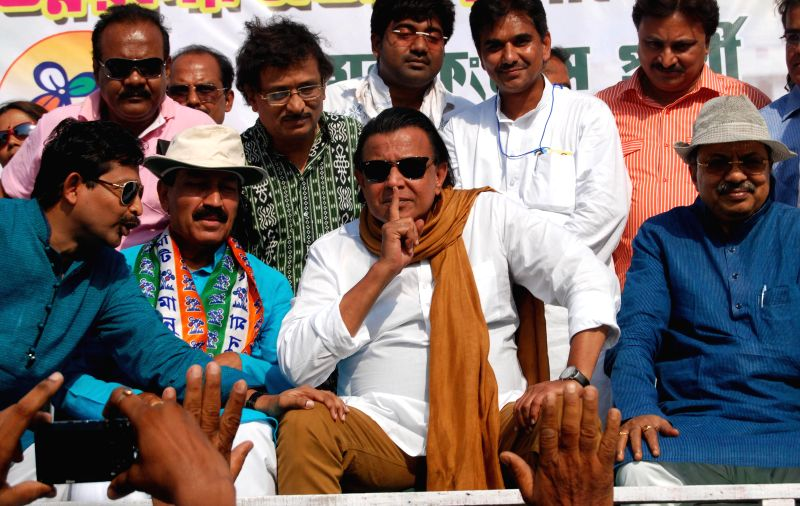 Howrah Loksabha constituency candidate Prasun Banerjee with actor Mithun Chakraborty during a campaigning ahead of the upcoming 2014 General Election at Howrah in West Bengal on 26 April 2014.