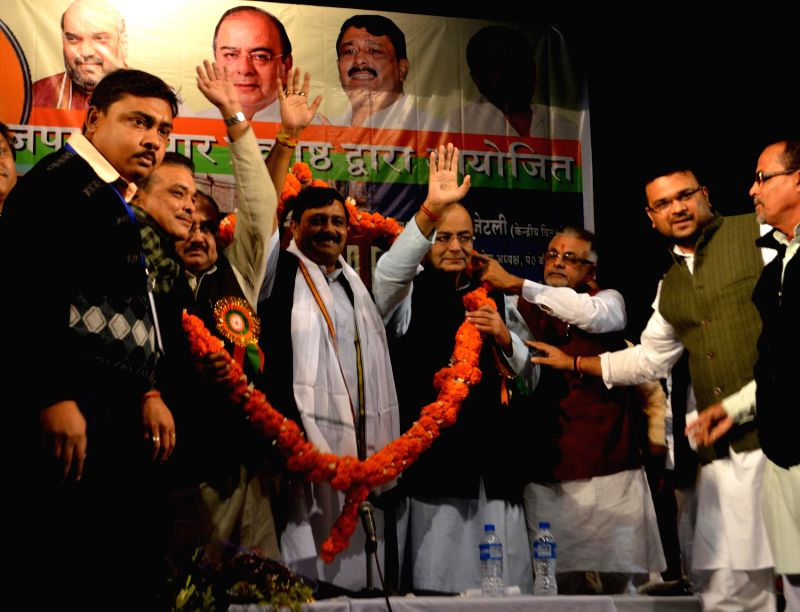 Union Minister for Finance, Corporate Affairs, and Information and Broadcasting Arun Jaitley, West Bengal BJP chief Rahul Sinha and others during a party programme in Howrah, on Jan 7, 2015.