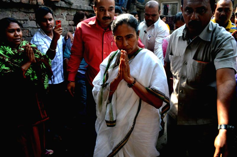 West Bengal Chief Minister Mamata Banerjee visits to Arup Bhandari`s house who was killed by the eveteaser in Howrah, West Bengal on Feb. 4, 2015. - Mamata Banerjee