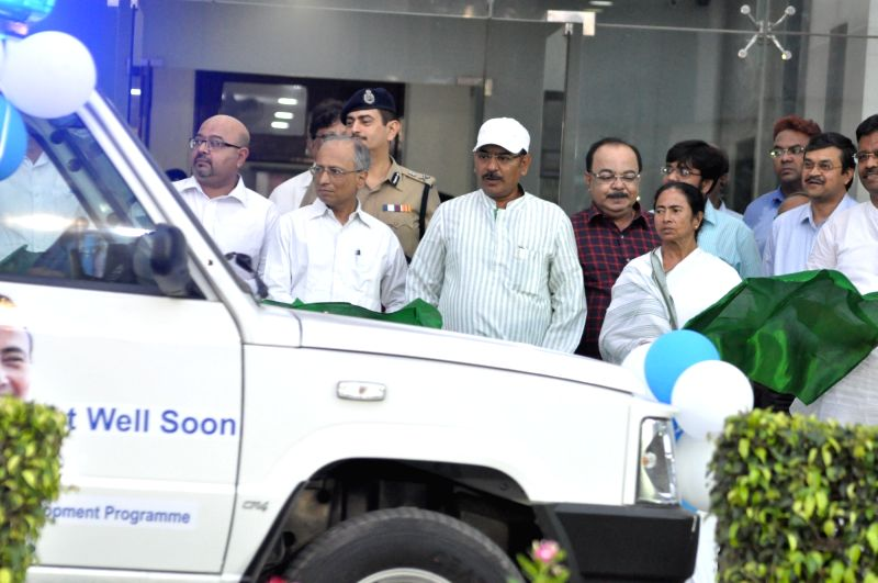 Howrah : West Bengal Chief Minister Mamata Banerjee flags off an ambulance from Nabanna in Howrah, on June 13, 2018. - Mamata Banerjee