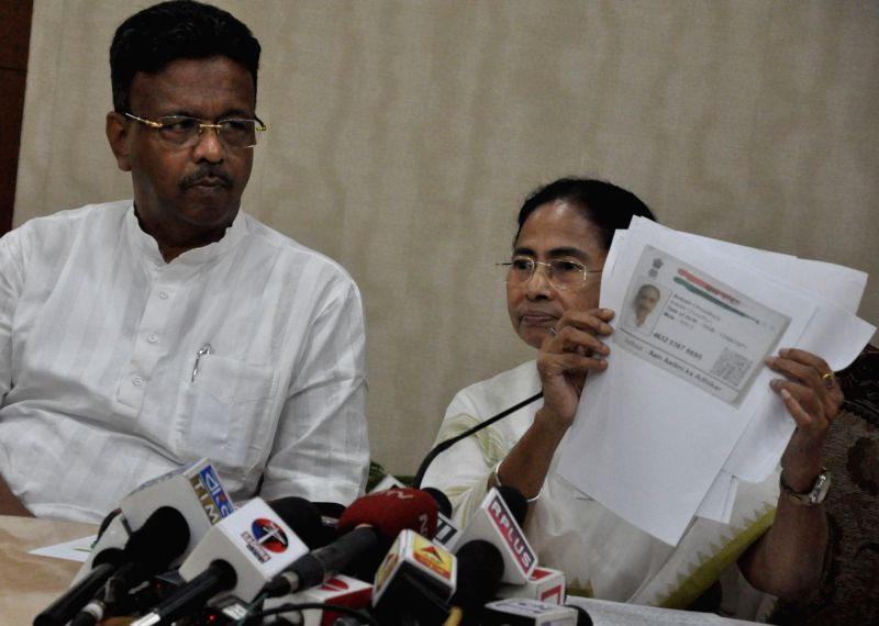: Howrah: West Bengal Chief Minister Mamata Banerjee addresses a press conference at Nabanna in Howrah, West Bengal on July 30, 2018. The first complete draft of the National Register of Citizens ...