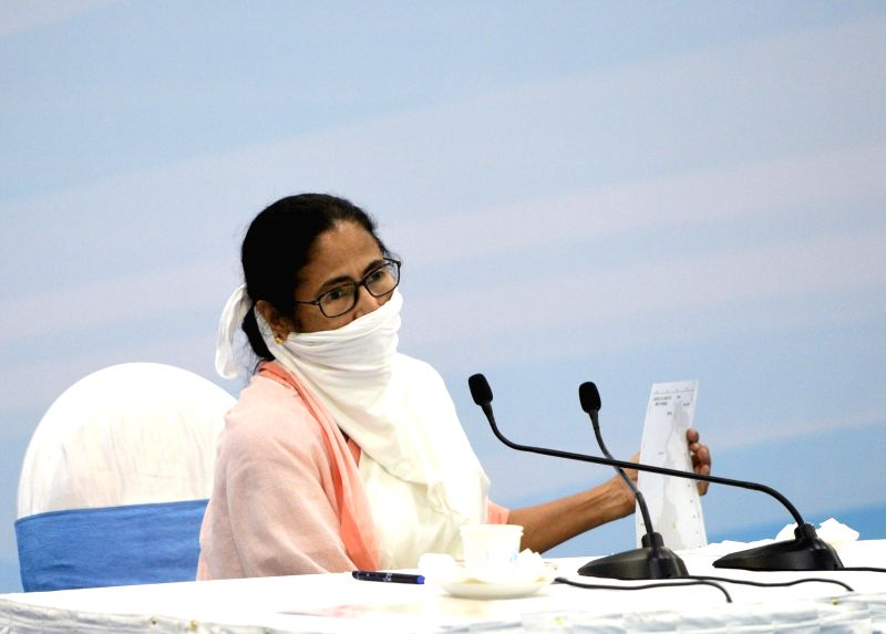 Howrah: West Bengal Chief Minister Mamata Banerjee during a meeting with Industrialist and Traders regarding  novel coronavirus (COVID 19) pandemic, in Howrah on April 9, 2020. (Photo: IANS)
