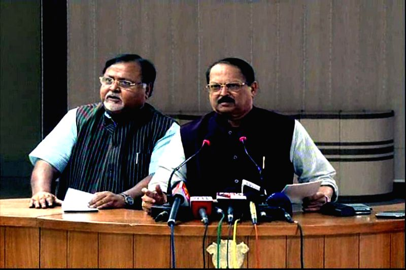 West Bengal Ministers Subrata Mukherjee and Partha Chatterjee during a press conference regarding the arrest of state transport minister and Trinamool Congress Madan Mitra by CBI, at Nabanna . - Subrata Mukherjee and Partha Chatterjee