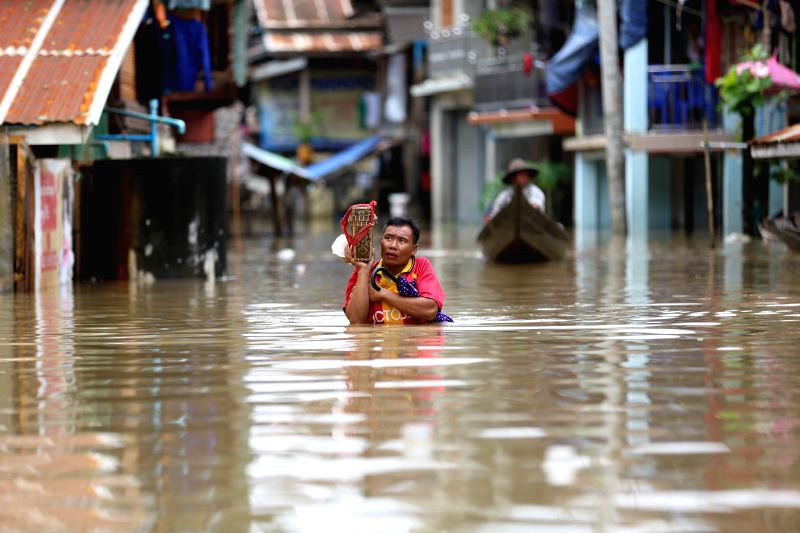 HPA-A resident wades through flood water in Hpa-an, the capital of Kayin State, Myanmar, July 24, 2018. People in Kayin state are being affected by flood due to the ...
