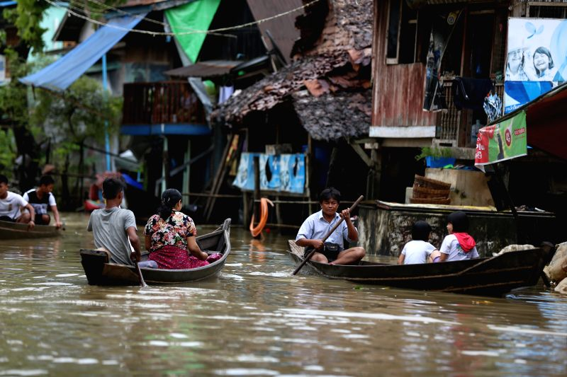 HPA-Residents paddle boat through a flooded street in Hpa-an, the capital of Kayin State, Myanmar, July 24, 2018. People in Kayin state are being affected by flood due ...