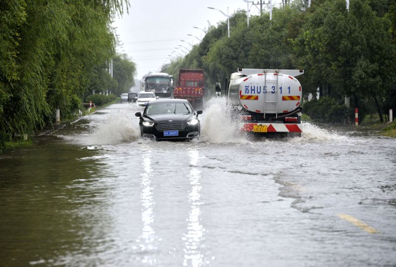 HUAI'Cars pass through a flooded road in Huai'an City, east China's Jiangsu Province, July 6, 2018. Heavy rain continued to batter southern provinces of China. ...