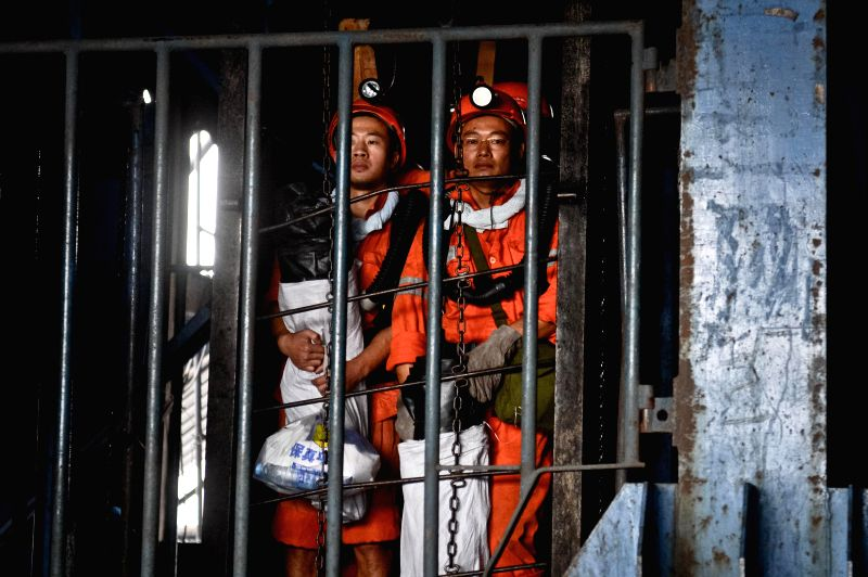 Rescuers prepare to enter the accident site in the Dongfang Coal Mine in Xiejiaji District of Huainan City, east China's Anhui Province, Aug. 22, 2014. Two bodies ..