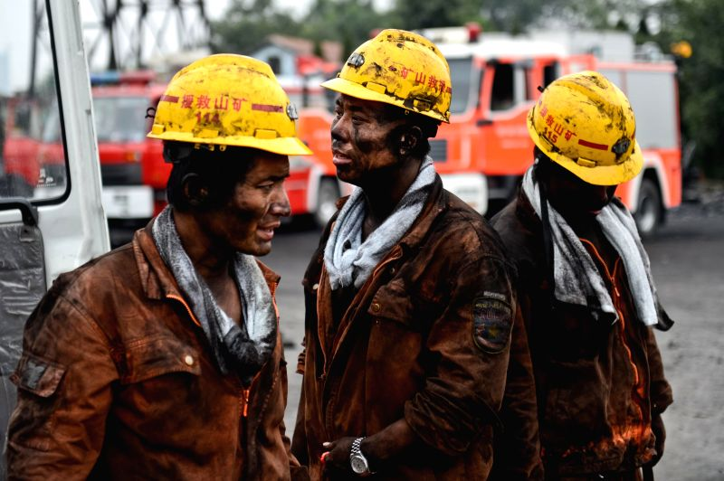 Rescuers return to the surface in the Dongfang Coal Mine in Xiejiaji District of Huainan City, east China's Anhui Province, Aug. 22, 2014. Two bodies have been ...