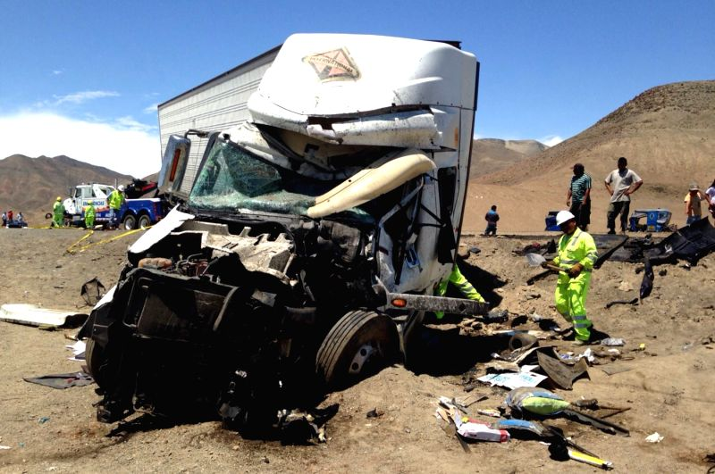 HUARMEY (PERU), March 23, 2015 People check the remains of a truck in the site of a collision that happened on the Pan American Highway near the city of Huarmey, Ancash Region, about 300 ...