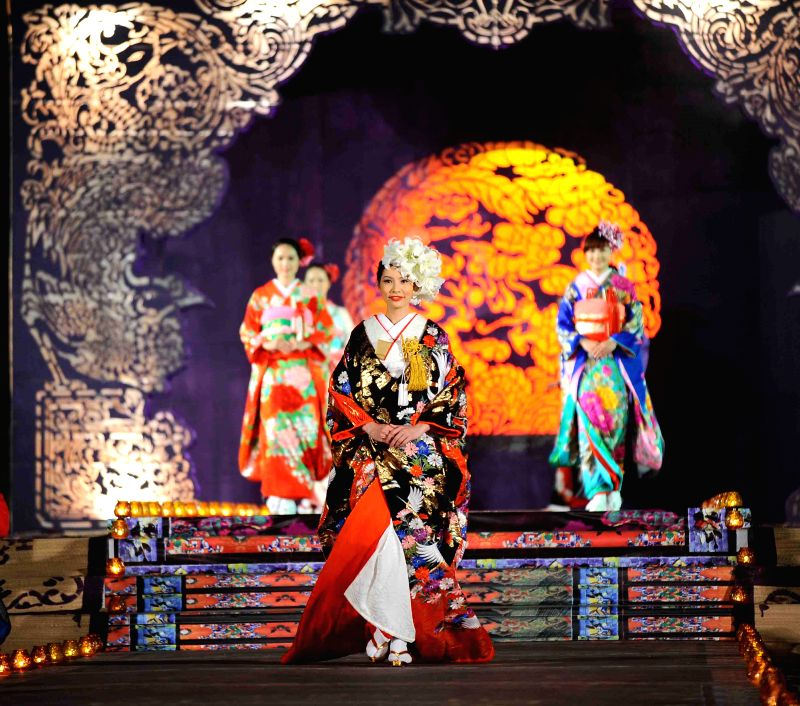 """A model presents Asian costume at the """"Oriental Night"""" show on the sidelines of the Hue Festival in Vietnam's central Thua Thien-Hue province, April 13, ..."""
