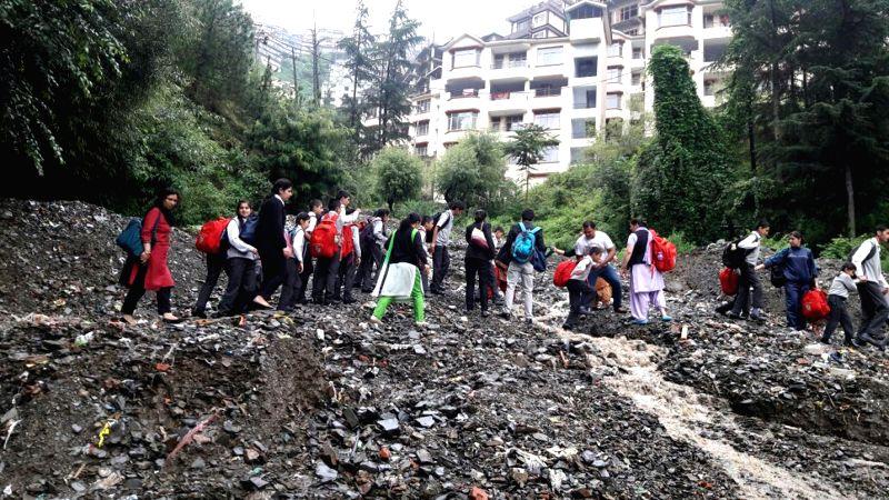 Huge debris blocked the road near Bhatkufar due to heavy rainfall in Shimla on July 29, 2016.