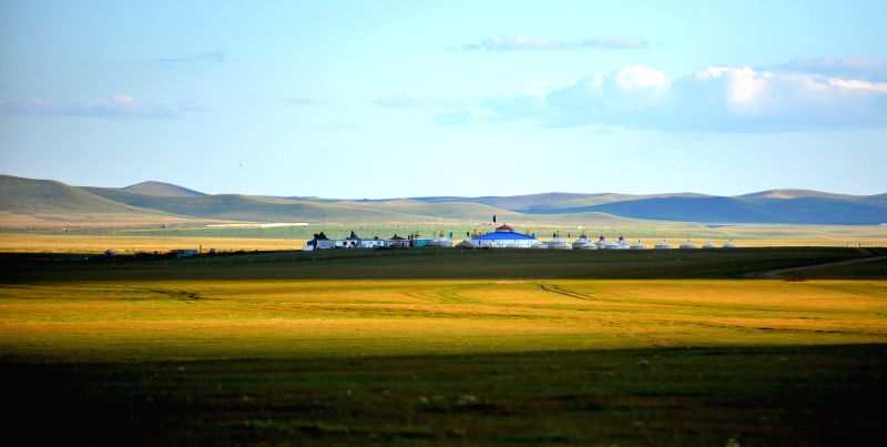 Photo taken on Aug. 21, 2014 shows the Mongolian yurts on the grassland of Hulun Buir, north China's Inner Mongolia Autonomous Region.  (Xinhua/Ren ...