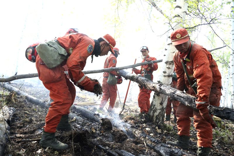 HULUNBUIR, May 20, 2017 - Firefighters work at the fire site in a forest in Chenbarerhu Banner in Hulunbuir City, north China's Inner Mongolia Autonomous Region, May 19, 2017. The forest fire that ...