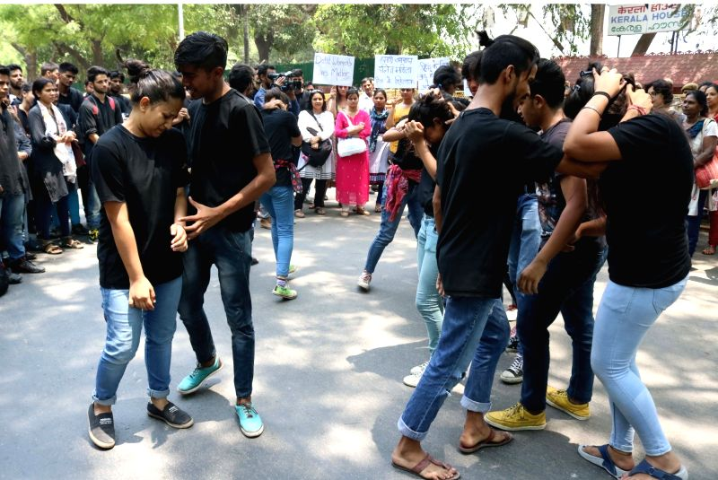 Human Rights activists perform a street play to protest against the sexual assault and murder of a dalit woman in Kerala, outside Kerala House in New Delhi, on May 12, 2016.