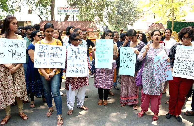 Human Rights activists stage a demonstration against the sexual assault and murder of a dalit woman in Kerala, outside Kerala House in New Delhi, on May 12, 2016.