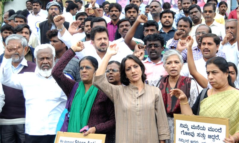 Human rights activists stage a demonstration against Dalit Assault Case at Una; in Bengaluru on July 22, 2016.