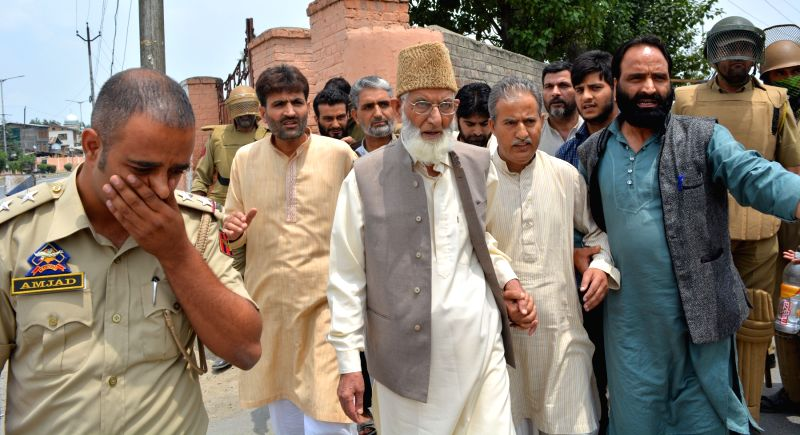 Hurriyat chaiman Syed Ali Shah Geelani arrested by police outside his residence in Srinagar on July 25, 2016.