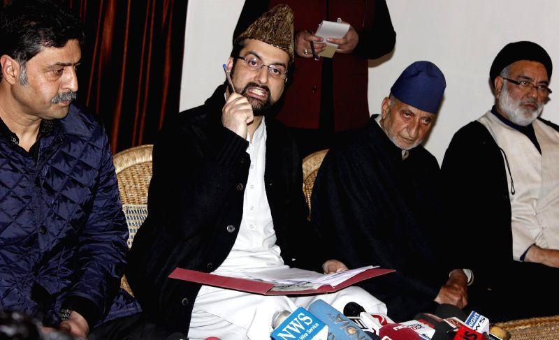 Hurriyat Conference chairman Mirwaiz Umar Farooq addressing a press conference in Srinagar on April 19, 2014.