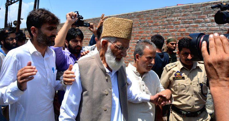 Hurriyat Conference Chairman Syed Ali Shah being taken away by police in Srinagar on July 29, 2016. - Syed Ali Shah