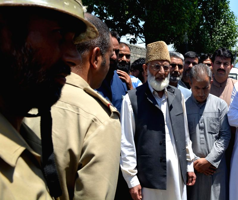 Hurriyat Conference (G) chairman Syed Ali Shah Geelani being taken in custody after he tried marching towards Hazratbal Shrine in Srinagar on Aug 5, 2016.